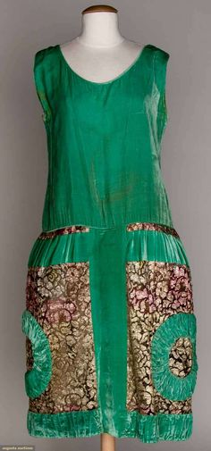 Velvet and Lame party dress, early 1920s:  Turquoise, drop waist, gold and pink metallic lace skirt w/ruched velvet rings, and gold lame under skirt.