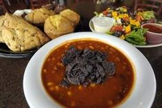 A few of the food offerings at Crystal Coffee Cafe include (at left) a sample platter of pastries and scones, the Nell Fiesta Salad (right) and Taco Soup (bottom). / Jim Matthews/Press-Gazette photo