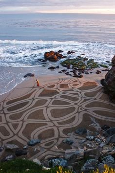 Andres Amador is an artist who uses the beach as his canvas, racing against the tide to create these large scale temporary masterpieces using a rake or stick ..  Andres' creations are simply stunning and knowing that these delicate creations are temporary somehow makes them even more beautiful.
