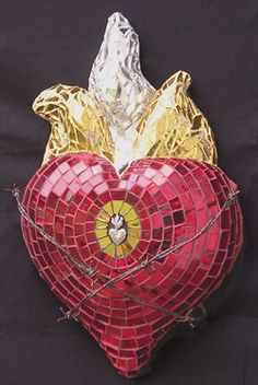 """""""Milagro Corazon"""" - by Andrea Shreve Taylor. Colored mirror, milagros, and barbed wire over original concrete and polystyrene sculpture. In art collection of House of Mo'Lola."""