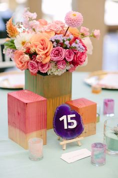 agate table numbers, photo by Joielala, styling by Amorology Weddings http://ruffledblog.com/artsy-san-diego-wedding #weddingideas #tablenumbers #agateslices