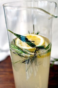 Name: Rosemary Gin Fizz  Recipe: -1 cup rosemary simple syrup (Boil one cup of sugar in one cup of water with a couple rosemary sprigs thrown in. Boil until the sugar is dissolved. Let cool.) -1 cup gin -1/4 cup fresh lemon juice  -1 bottle of Prosecco (or 2, if you want the cocktail to be lighter)  Notes: Stir ingredients together in a punch bowl or carafe, and garnish with sprigs of rosemary.