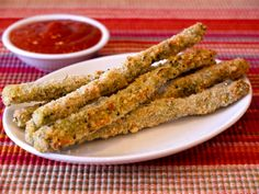 Italian Asparagus Sticks (Serves 4)    1 Cup Whole Wheat Panko or Bread Crumbs  1 Tbsp Italian Herbs (you can find them in any grocery's spice section)  1/2 Tsp Salt  1/2 Tsp Garlic Powder  2 Large Eggs  1/4 Cup Flour  1 Bunch Asparagus, cleaned and stems removed (if you snap the asparagus down towards the bottom, they will naturally break at the woody part at the bottom)