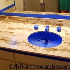 See how to paint countertops with laminate countertop paint and learn this quick way to completely change the look of your room.
