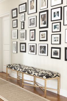 #family-photos, #photos, #bench, #home-decor, #entryway, #gallery-wall, #black-and-white, #fabric, #frame, #hallway  Photography: Courtney Apple - courtneyapple.com  Read More: http://www.stylemepretty.com/living/2014/04/22/chestnut-hill-project/