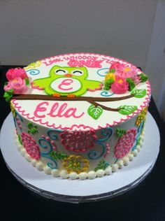 White Round Cake with Lime Owl and Fuchsia, Aqua, Green, Yellow and Orange Flowers & Swirls