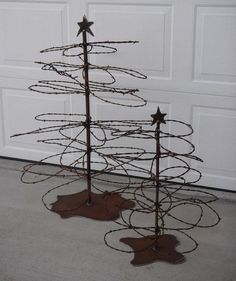 Interesting concept... creating a Christmas tree out of barb wire that is haphazardly thrown about in the shape of a tree. Like the primitive approach!