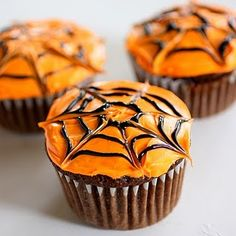 Spiderweb Cupcakes--chocolate cake mix, cream cheese icing with orange food coloring, piped black circles, then draw a toothpick or knife thru circles to create web....