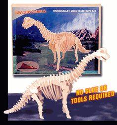 """52 piece wooden dinosaur puzzle 22""""Lx4""""Wx11.5""""H $6.99"""