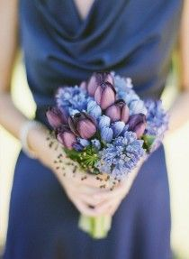 Bridesmaid navy and purple bouqet.