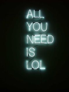 neon 'all your need is lol' sign