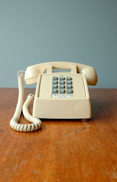 """My family growing up in the 80's had a phone like this. Now it's considered """"vintage!"""" :) Vintage Cream Push Button Phone by luola  on Etsy - $35.00"""