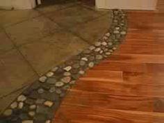 River rocks between tile and wood floor