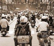 Lets all ride our Vespas.