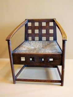The armchair (1904) is one of three originally for the entrance hall of Hill House, Helensburgh, Scotland. It is of unstained oak and has a rush seat. The strong use of horizontal and vertical lines was often a feature of Mackintosh's designs. This is located in an exhibit of Charles Rennie Mackintosh's (1868-1928) work at the Virginia Museum of Fine Arts in Richmond, Virginia.