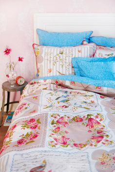 PiP Studio / vintage handkerchief bed linens.  Or sew one on an embroidered pillow case or sham.