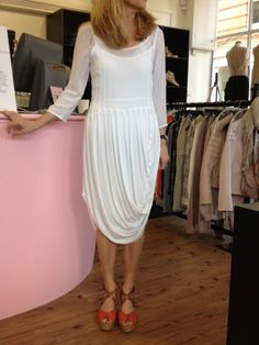 Louise is wearing the white draped dress from Handwritten by Tanya Sarne (£280) and the coral Parasol wedges by Ash.     http://www.stanwells.com/by-designer-1/handwritten-clothing/handwritten-white-draped-dress
