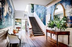 Trend Alert: Panoramic Murals // Foyer With Zuber Mural Wallpaper, Staircase, Console, and Settee