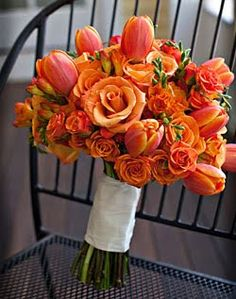 By using different shades of orange, the flowers give more depth to give this bouquet an fresh, bright and alluring look! spray, flower bouquets, color, tulip, red roses, amsterdam, oranges, fresh flower, flowers