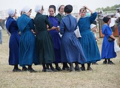 Amish women in their blue dresses