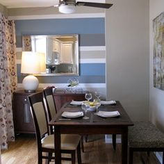 Interesting horizontal stripe pattern in a dining room.