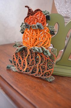 quilled pumpkins piled up
