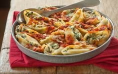 Baked Spinach and Ricotta Stuffed Pasta Shells // This pasta dish will soon become a family favorite. In a hurry? Use a cup of thawed frozen spinach instead of fresh; just be sure to squeeze it well to remove any excess water. Serve with garlic bread and a fresh salad for a complete meal.