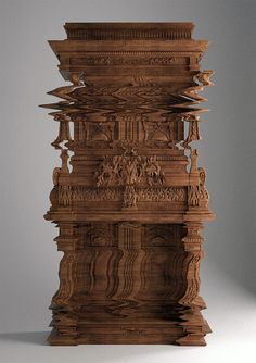 Nope, not Photoshop. This wooden cabinet was purposely carved to look like a digital glitch. The the rest of it on Colossal:    http://www.thisiscolossal.com/2013/03/good-vibrations-an-intricately-carved-cabinet-looks-like-a-digital-glitch