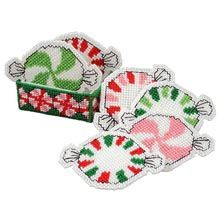 Attachments: Peppermint Coasters w/Holder. . . Oh, man! Why didn't I find this BEFORE Christmas? My whole theme was peppermint candies and red and white decor. :)
