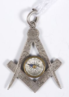 A late Victorian white-metal Masonic compass fob. (Reeman Dansie)