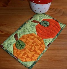 Pumpkin Patch Mug Rug from The Patchsmith | Check out patterns on Craftsy!