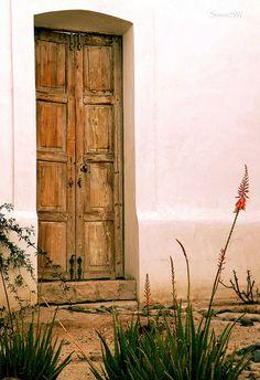 An old door in the El Presidio Historic District, Tucson, Arizona - By: ScenicSW