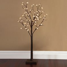 Fitted with glowing LED lights, this realistic 4' Cherry Blossom Tree comes alive in your home to create a dramatic ambience. Use this nature-inspired piece in your entryway to welcome guests or place it inside a decorative pot for a unique, custom look.