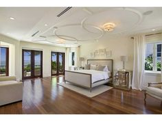 This bedroom has unique ceiling molding, beautiful beach and ocean views. Miami Beach, FL Coldwell Banker Residential Real Estate
