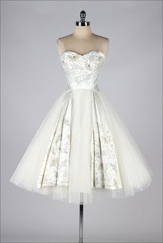 1950's wedding dress made with satin tulle, with rhinestones pearls adorning it is just heavenly.