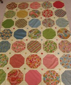 scrappy charm square or layer cake quilt. Use picture for idea... No link.