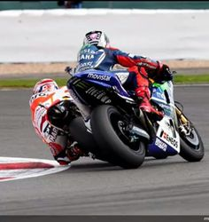 Marc marquez and Jorge Lorenzo getting a little close together at Silverstone 2014