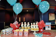 Super stylish bowling party. Amazed at how great she made the bowling alley look. Also love the gumball bowling balls on the cupcakes!