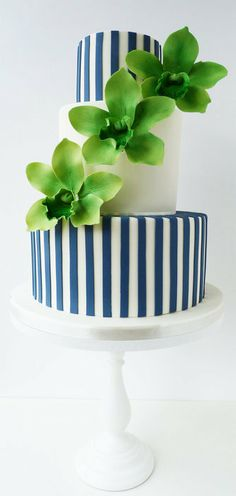 green orchids and Navy stripes wedding cake
