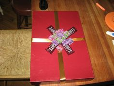 My daughter came up with this idea.  Instead of putting a bow on a gift she made one out of snack size hershey   bars and individual Laffy Taffy. Flickr.com