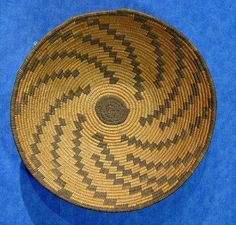 Apache basket from about 1900 that has aged beautifully and shows a master hand in the tight weave and even stitches.