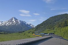 The Coastal ClassicTrain, Alaska  The tourist draws include enormous glaciers spied from the towering Kenai Mountains, glimpses of Beluga whales along the coast of Turnagain Arm and optional dog sledding in the holiday resort of Girdwood along the way. That's not to mention the additional acres of alpine hills, wildflower-filled verges and glacial landscapes along the way. Running between Anchorage and Seward on it takes 4 hrs one way, leaving plenty of time for a few stop-overs along the way.