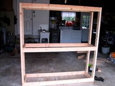 Build your own garage shelf for under $30.   Be cheap and DIY: