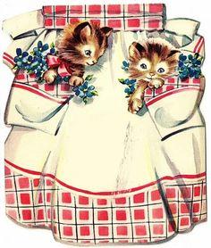 Kittens in apron