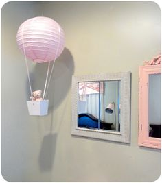 DIY Hot Air Balloon using a paper lantern and a box from the gift wrap section of the store! #DIY #nursery
