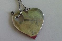 Heart with a heart-shaped hole - symbolizing a miscarriage.