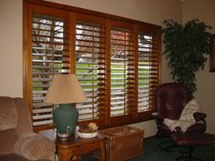Find these stained plantation shutters at Horizon Shutters.