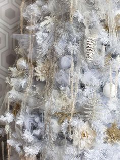 What sets white-on-white #Christmas trees apart from others is their restrained use of color, relying on different ones and shades of the same hue rather than contrasting colors.  #HolidayHouse