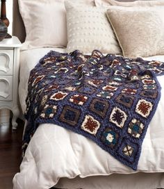Check out this free crochet afghan pattern from Bernat. The Patchwork Lacy Crochet Afghan is just what you've been looking for.