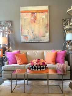 neutral sofa, pops of color, wrought iron, and fun art....perfection! (designed by Post 31 Interiors)